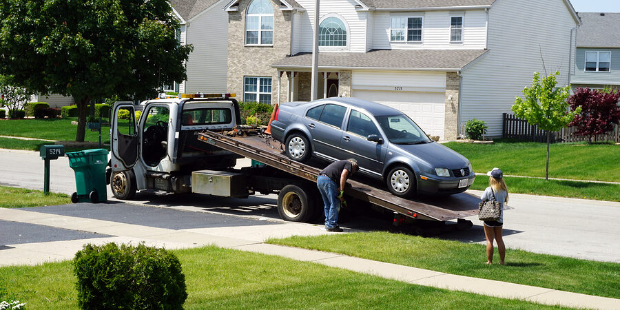 black car in the towing truck